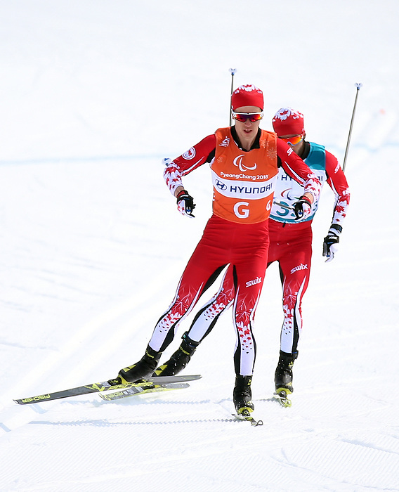 Brian McKeever, PyeongChang 2018 - Para Nordic Skiing // Ski paranordique.<br /> Brian McKeever wins gold in the cross country 20km visually impaired race with guide Graham Nishikawa // Brian McKeever remporte l'or dans le cross-country 20 km course ayant une déficience visuelle avec son guide Graham Nishikawa. 12/03/2018.