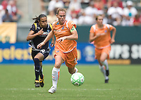 Sky Blue FC's Christie Rampone runs down a ball the ball in front of LA Sol's Marta during a Sky Blue FC 1-0 victory over the LA Sol to win the WPS Championship match at the Home Depot Center, Saturday, August 22, 2009.