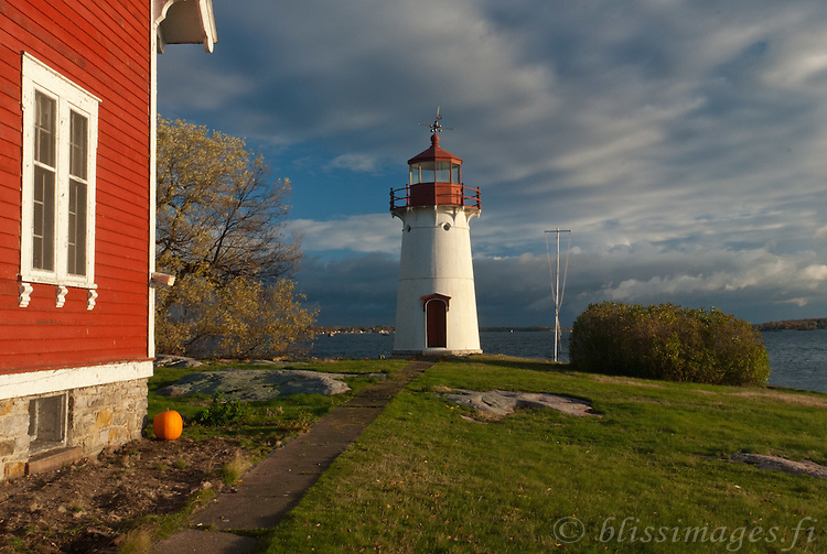 Signs of a passing storm and Halloween at Crossover Island Lighthouse located in the St. Lawrence River's 1000 Islands between Brockville, Ontario and Alexandria Bay, New York State.