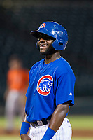 AZL Cubs shortstop Delvin Zinn (21) laughs with field umpire Pete Talkington (not pictured) during a game against the AZL Giants on September 6, 2017 at Sloan Park in Mesa, Arizona. AZL Giants defeated the AZL Cubs 6-5 to even up the Arizona League Championship Series at one game a piece. (Zachary Lucy/Four Seam Images)