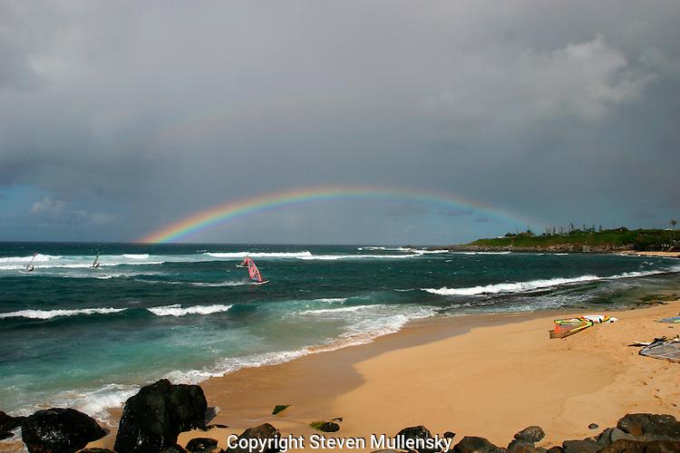 Windsurfers take advantage of the brisk winds at Maui's Pa'ia beach.