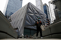 NEW YORK - NEW YORK - APRIL 02: A man walks near to The Shed at Hudson Yards on April 02, 2021 in New York. New York takes another step forward to reopening arts and entertainment, venues are allowed to welcome back people with the guidelines say indoor spaces can have up to 100 audience members and outdoor venues can have 200. (Photo by John Smith/VIEWpress)