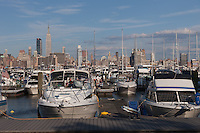 Boats in Lincoln Harbor Marina in Weehawken, NJ with the skyline of Manhattan in the background.
