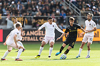 LOS ANGELES, CA - MARCH 01: Francisco Ginella #8 of LAFC dribbles through a group of Inter Miami CF defenders during a game between Inter Miami CF and Los Angeles FC at Banc of California Stadium on March 01, 2020 in Los Angeles, California.