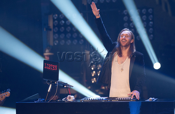 The French House DJ and music producer David Guetta stands on stage during the final of the TV show 'The Voice of Germany' in Berlin, Germany, 12 December 2014. The show is aired on the Sat.1 TV channel. Photo: Joerg Carstensen/dpa
