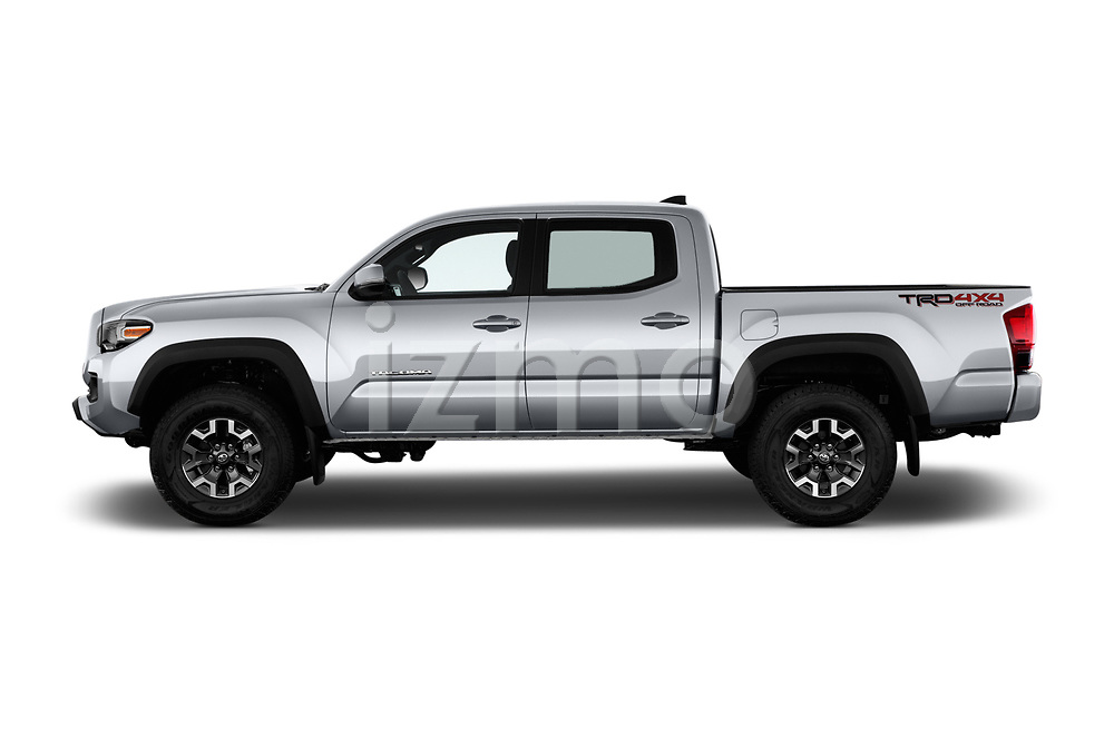 Car driver side profile view of a 2018 Toyota Tacoma TRD Off Road Double Cab 4 Door Pick Up