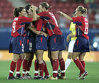 26 August 2004: Mia Hamm and Abby Wambach celebrate with Lindsay Tarpley after Tarpley scored a goal in the game against Brazil at Karaiskakis Stadium in Athens, Greece.   USA defeated Brazil 2-1 in overtime.   Credit: Michael Pimentel / ISI.