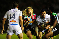 Matt Hopper of Harlequins hassles Geoffrey Palis of Castres Olympique during the European Rugby Champions Cup  Round 1 match between Harlequins and Castres Olympique at the Twickenham Stoop on Friday 17th October 2014 (Photo by Rob Munro)