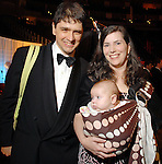 Jennifer and Edward Nawotka with Eden at the Houston Rockets Tux & Tennies benefit at Toyota Center Thursday March  27,2008. (Dave Rossman/For the Chronicle)