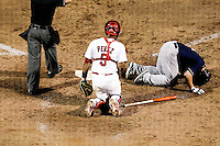 Paul McAnulty (21) of the Arkansas Travelers falls to the ground after being hit by a pitch during a game against the Springfield Cardinals at Hammons Field on July 25, 2012 in Springfield, Missouri. (David Welker/Four Seam Images)