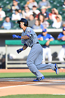 Biloxi Shuckers shortstop Mauricio Dubon (10) runs to first base during a game against the Tennessee Smokies at Smokies Stadium on May 26, 2017 in Kodak, Tennessee. The Smokies defeated the Shuckers 3-2. (Tony Farlow/Four Seam Images)