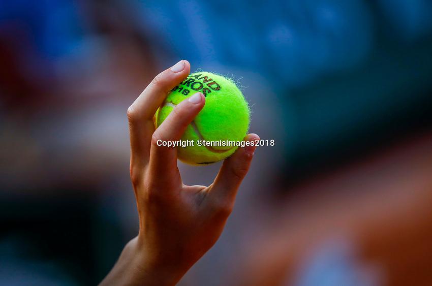 Paris, France, 27 May, 2018, Tennis, French Open, Roland Garros, Ballboy holding Roland Garros ball<br /> Photo: Henk Koster/tennisimages.com