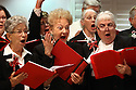 The Carlsbad Choraleers put a rousing ending on Have Yourself A Merry Little Christmas during a dress rehearsal at the Carlsbad Senior Center.