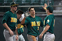 Siena Saints center fielder Dan Swain (22) celebrates with teammates Ryan Stefaniak (15), Tyler Matis (1), and Carlos Tapia (29) after hitting a home run during a game against the Stetson Hatters on February 23, 2016 at Melching Field at Conrad Park in DeLand, Florida.  Stetson defeated Siena 5-3.  (Mike Janes/Four Seam Images)