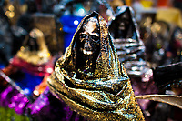 Figurines of Santa Muerte (Saint Death) are seen placed outside the shrine in Tepito, a dangerous neighborhood of Mexico City, Mexico, 1 May 2011. The religious cult of Santa Muerte is a syncretic fusion of Aztec death worship rituals and Catholic beliefs. Born in lower-class neighborhoods of Mexico City, it has always been closely associated with crime. In the past decades, original Santa Muerte's followers (such as prostitutes, pickpockets and street drug traffickers) have merged with thousands of ordinary Mexican Catholics. The Saint Death veneration, offering a spiritual way out of hardship in the modern society, has rapidly expanded. Although the Catholic Church considers the Santa Muerte's followers as devil worshippers, on the first day of every month, crowds of believers in Saint Death fill the streets of Tepito. Holding skeletal figurines of Holy Death clothed in a long robe, they pray for power healing, protection and favors and make petitions to 'La Santísima Muerte', who reputedly can make life-saving miracles.