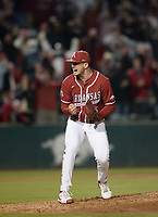 Arkansas reliever Kevin Kopps reacts Friday, April 2, 2021, after recording the final out of the Razorbacks' 6-5 win over Auburn at Baum-Walker Stadium in Fayetteville. Visit nwaonline.com/210403Daily/ for today's photo gallery. <br /> (NWA Democrat-Gazette/Andy Shupe)
