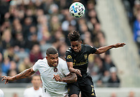 LOS ANGELES, CA - MARCH 01: Roman Torres #29 of Inter Miami CF and Latif Blessing #7 battle in the air for a ball during a game between Inter Miami CF and Los Angeles FC at Banc of California Stadium on March 01, 2020 in Los Angeles, California.