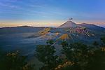 Mount Semeru erupting above Bromo caldeira, Java, Indonesia, 2002.