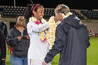 STANFORD, CA - October 21, 2012: Mariah Nogueira with her family and Head Coach Paul Ratcliffe during the Senior Day celebration after the Stanford vs Washington women's soccer match in Stanford, California.  Stanford won 3-0.
