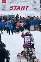 DeeDee Jonrowe team leaves the start line during the restart day of Iditarod 2009 in Willow, Alaska