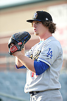 Grant Holmes (14) of the Rancho Cucamonga Quakes throws in the bullpen before pitching against the Lancaster JetHawks at The Hanger on April 19, 2016 in Lancaster, California. Rancho Cucamonga defeated Lancaster, 10-6. (Larry Goren/Four Seam Images)