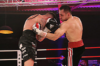 19th December 2020, Hamburg, Germany; Universal Boxing Promotion fight, Felix Sturm versus Timo Rost; Body shot from Rost