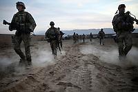 Afghanistan, 26.10.2011, Nawabad. Nach der Notlandung einer Drohne ziehen Soldaten abends aus, um das Geraet zu bergen. Die in Kundus stationierte 3. Task Force (ISAF) der Bundeswehr beginnt im Oktober 2011 die mehrtaegige Operation Orpheus. Durch Patrouillen in und um die Kleinstadt Nawabad (Dirstrikt Chahar Dareh) westlich von Kundus, Nordafghanistan, versuchen die rund 100 Infanteristen Rueckzugsorte Aufstaendischer unmoeglich zu machen. Unterstuetzt werden sie dabei durch einen Zug afghanischer Soldaten. After an unmanned drone has landed irregularly in Nawabad a platoon had to do out spontaneously at dusk to rescue the surveillance device. In October 2011 Kunduz based 3.Task Force started a several days operation in and around Nawabad (District Chahar Dareh), west of Kunduz, northern Afghanistan. During the Operation Orpheus about 100 german infantry soldiers went out for patrols through the town and surrounding areas, which were expected as a retreat zone of insurgents. A platoon of afghan soldiers supports the german forces. © Timo Vogt/Est&Ost, NO MODEL RELEASE !!