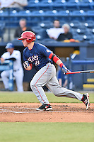 Hagerstown Suns catcher Jackson Reetz (21) swings at a pitch during a game against the Asheville Tourists at McCormick Field on April 27, 2016 in Asheville, North Carolina. The Tourists defeated the Suns 14-7. (Tony Farlow/Four Seam Images)