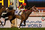 DUBAI,UNITED ARAB EMIRATES-MARCH 26: Real Steel ,ridden by Ryan Moore,wins the Dubai Turf at Meydan Racecourse on March 26,2016 in Dubai,UAE (Photo by Kaz Ishida)