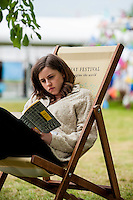 Wednesday  01 June 2016<br /> Pictured: A young woman reads a book on a deckchair in the fine weather at hay<br /> Re: The 2016 Hay festival take place at Hay on Wye, Powys, Wales