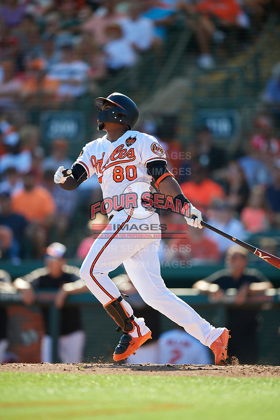 Baltimore Orioles right fielder Yusniel Diaz (80) follows through on a swing during a Grapefruit League Spring Training game against the Detroit Tigers on March 3, 2019 at Ed Smith Stadium in Sarasota, Florida.  Baltimore defeated Detroit 7-5.  (Mike Janes/Four Seam Images)