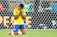Luiz Gustavo of Brazil looks dejected