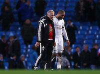 Swansea City caretaker manager Alan Curtis with Ashley Williams at the end of the game during the Barclays Premier League match between Manchester City and Swansea City played at the Etihad Stadium, Manchester on December 12th 2015