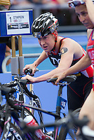 31 MAY 2014 - LONDON, GBR - Jodie Stimpson (GBR) (ENG)  of Great Britain and England exits transition for the start of the bike during the elite women's 2014 ITU World Triathlon Series round in Hyde Park, London, Great Britain (PHOTO COPYRIGHT © 2014 NIGEL FARROW, ALL RIGHTS RESERVED)