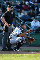 Scranton Wilkes-Barre Yankees catcher Jesus Montero #21 in the field in front of umpire Toby Basner during a game against the Rochester Red Wings at Frontier Field on April 9, 2011 in Rochester, New York.  Rochester defeated Scranton 7-6 in twelve innings.  Photo By Mike Janes/Four Seam Images