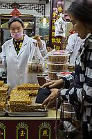 Yangzhou, Jiangsu, China.  Snacks and Candy Vendor, Dong Guan Street.