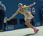 Caroline Wozniacki (DEN) wins 7-6, 4-3 as Shuai Peng (CHN) retires with injury at the US Open being played at USTA Billie Jean King National Tennis Center in Flushing, NY on September 5, 2014