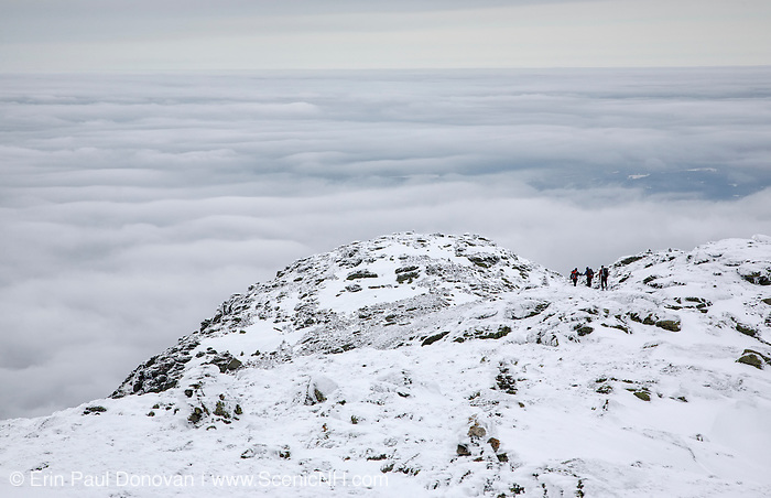 Three hikers travel north along the Appalachian Trail, near Mount Lafayette, during the winter months in the New Hampshire White Mountains.