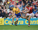 Shane O Donnell of Clare in action against Christopher Joyce of Cork during their Munster Senior game at Pairc Ui Chaoimh. Photograph by John Kelly.