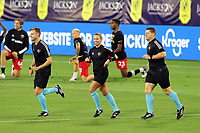 NASHVILLE, TN - SEPTEMBER 23: Referee Tori Penso warms up with assistant referees Logan Brown and Jeremy Hanson before a game between D.C. United and Nashville SC at Nissan Stadium on September 23, 2020 in Nashville, Tennessee.