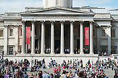 Tourists outside the National Gallery, Trafalgar Square, London.
