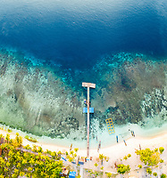 aerial view of a village jetty on Mansoear Island, aerial view of Raja Ampat Islands, West Papua, Indonesia, Pacific Ocean