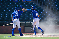 Kansas City Royals right fielder Seuly Matias (17) is congratulated by Nick Pratto (13) after sliding into home plate during an Instructional League game against the Cincinnati Reds on October 2, 2017 at Surprise Stadium in Surprise, Arizona. (Zachary Lucy/Four Seam Images)
