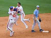 The Clemson Tigers celebrate their 11th inning 4-3 win over the North Carolina Tar Heels at Durham Bulls Athletic Park May 23, 2009 in Durham, North Carolina.  (Photo by Brian Westerholt / Four Seam Images)