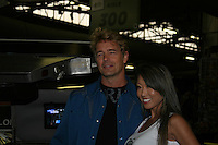 John Schneider - Loving - Dukes of Hazzard poses with Delorean car from Back to the Future and model as he appears at Big Apple Comic Con for autographs and photos on October 16 (and 17 & 18), 2009 at Pier 94, New York City, New York. (Photo by Sue Coflin/Max Photos)