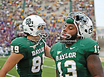 Baylor Bears wide receiver Thomas Draper (89) and Baylor Bears defensive tackle Tracy Robertson (13) in action during the game between the Stephen F. Austin Lumberjacks and the Baylor Bears at the Floyd Casey Stadium in Waco, Texas. Baylor defeats SFA 48 to 0.