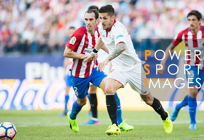 Stevan Jovetic (r) of Sevilla FC runs past Diego Roberto Godin Leal of Atletico de Madrid during their La Liga match between Atletico de Madrid and Sevilla FC at the Estadio Vicente Calderon on 19 March 2017 in Madrid, Spain. Photo by Diego Gonzalez Souto / Power Sport Images