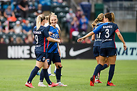 TACOMA, WA - JULY 31: Eugenie Le Sommer #9 of the OL Reign celebrates with her teammates during a game between Racing Louisville FC and OL Reign at Cheney Stadium on July 31, 2021 in Tacoma, Washington.