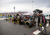 Oct 3, 2020; Madison, Illinois, USA; Crew members push the dragster of NHRA top fuel driver Chris Karamesines  during qualifying for the Midwest Nationals at World Wide Technology Raceway. Mandatory Credit: Mark J. Rebilas-USA TODAY Sports