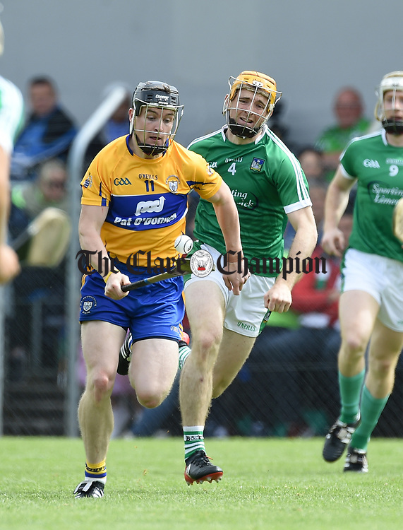 Tony Kelly of Clare in action against Ritchie English of Limerick during their Munster championship game in Ennis. Photograph by John Kelly.